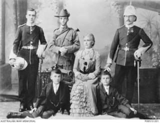 Studio portrait of William Thomas Bryan, of Perth, WA,  with his parents and brothers. Standing left to right: William Thomas; Cyril (wearing a cadet uniform); and  Lieutenant Thomas Joseph Bryan ..