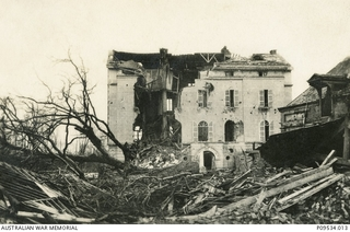 """Chateau Nieppe, near Armentieres. All the trees were cut down by the Boche."" 'These were the billets of A4 Coys for many weeks & from the square in front of this we left as independent Coys for .."