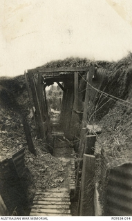 """One of the overhead covers in St Yves communication trench (CT) near BHQ looking east."" 'A spot well known to thousands of us'. (One of a collection of photographs belonging to Lieutenant (Lt) .."