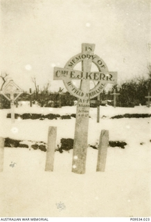 """Captain Kerr's grave."" 'I was present at his funeral.'  Original cross on the grave of Captain (Capt)  Eric John Kerr, 11th Field Ambulance, in Ypres Reservoir Cemetery (also known as Prison .."