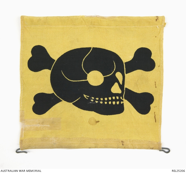 Souvenir from Germany – a land mine warning flag souvenired by Colin Fraser from the German barracks at Ingolstadt shortly after his release as a prisoner of war. REL25206.
