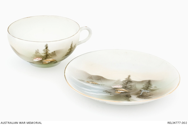 Eleven Japanese manufactured tea cups and saucers : Stoker Petty Officer E B Powell, RAN.REL34777.