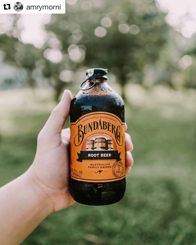 Hand holding a full bottle of Bundaberg Root Beer