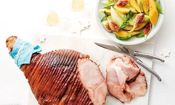 Christmas ham served with sliced fruit