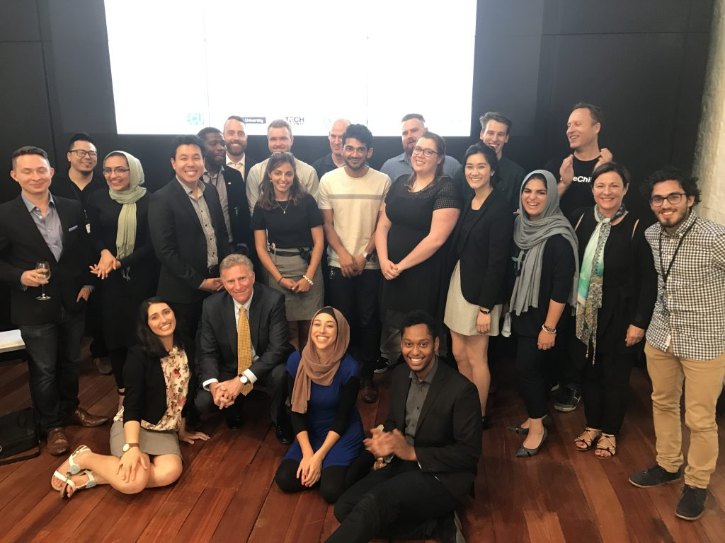 Hackathon participants, organisers and interim US Ambassador James Carouso