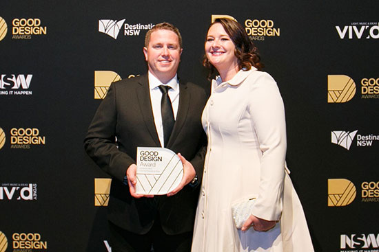 Two people accepting a Good Design Award