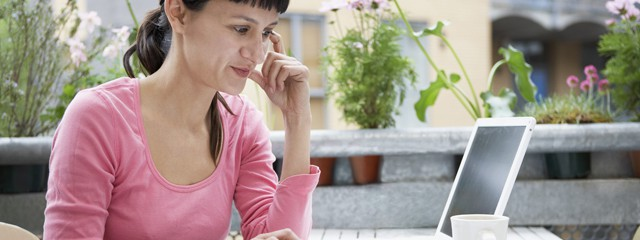 Lady sitting outside calculating depreciation