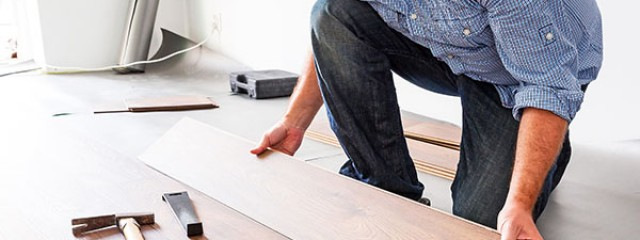 Man replacing floorboards