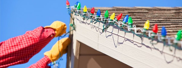 hanging Christmas lights on an investment property