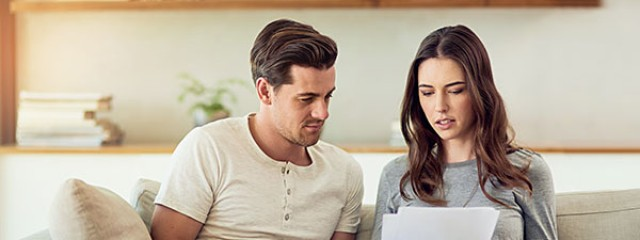 Young couple researching the property market
