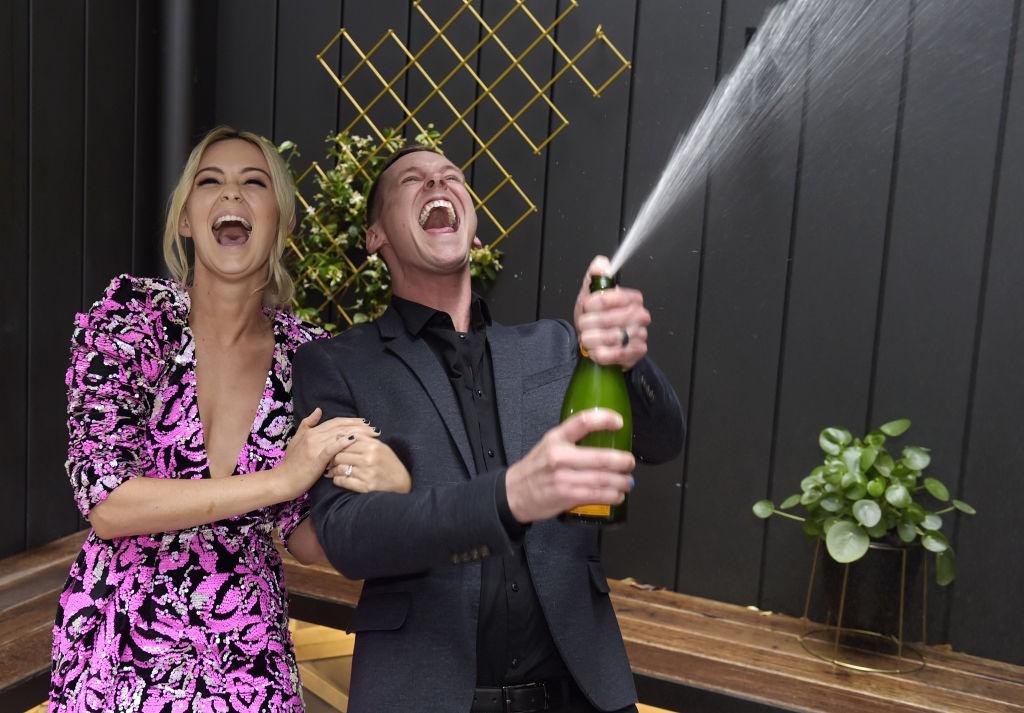 Tess and Luke celebrating their win - Domain