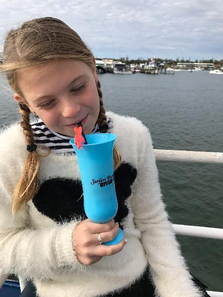 My daughter enjoying her drink.