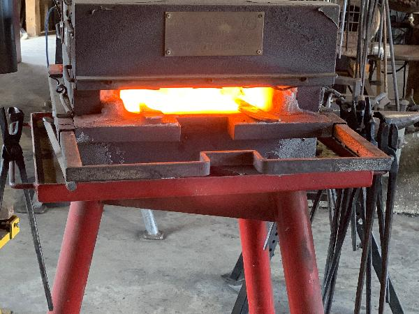 Heating the metal before working on it.