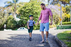 father walks son to school