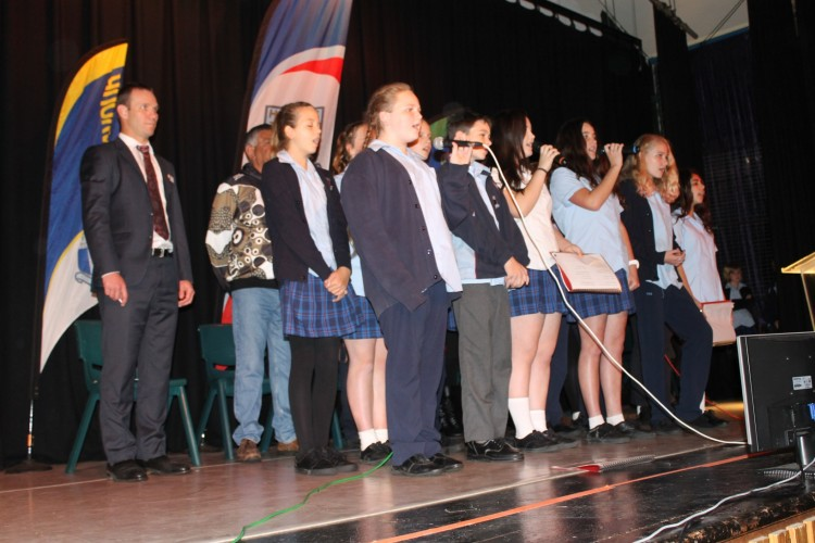 DP Andrew Pesle, Toronto-hs choir Singing Advance Australia Fair in Awabakal Language