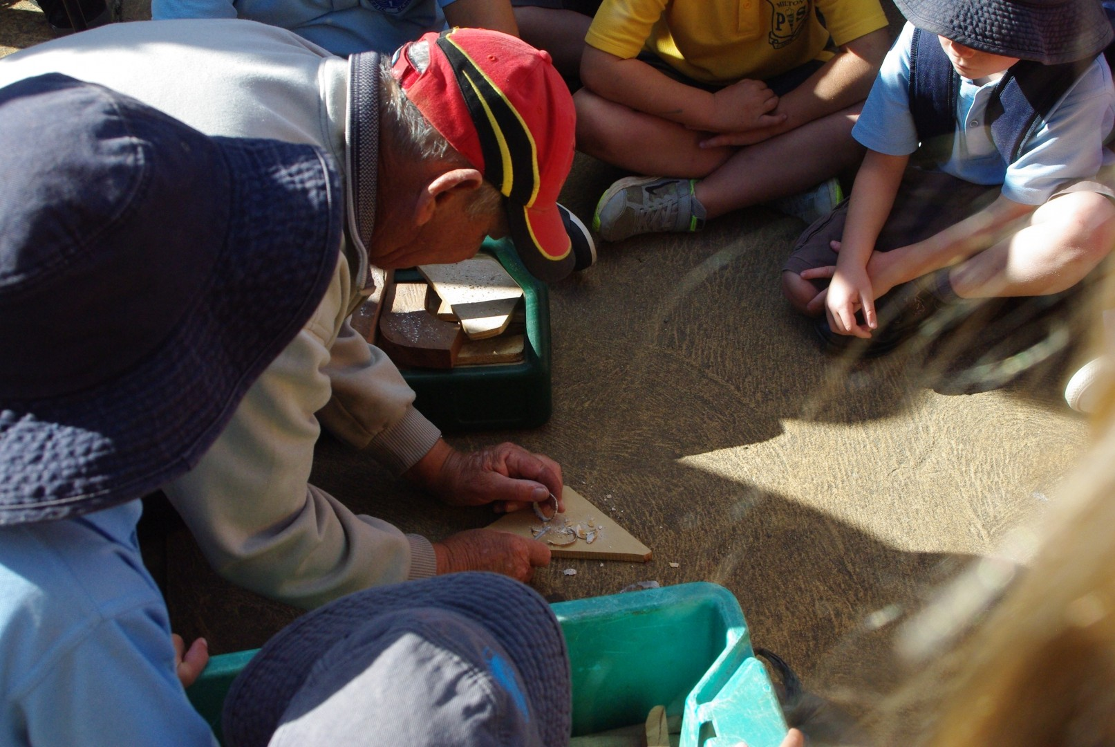 Uncle Fred teaches the children how to make traditional fish hooks.