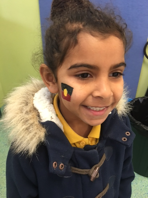 Mia loves her face painting of the Koori flag