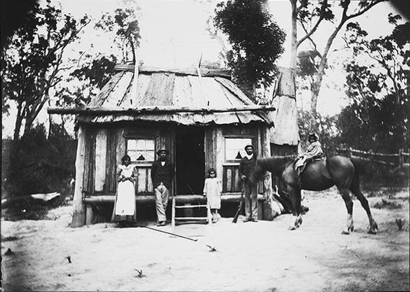 Plate 2: Aboriginal family outside their house, from the W.H. Corkhill Tilba Tilba Collection, c.1900.