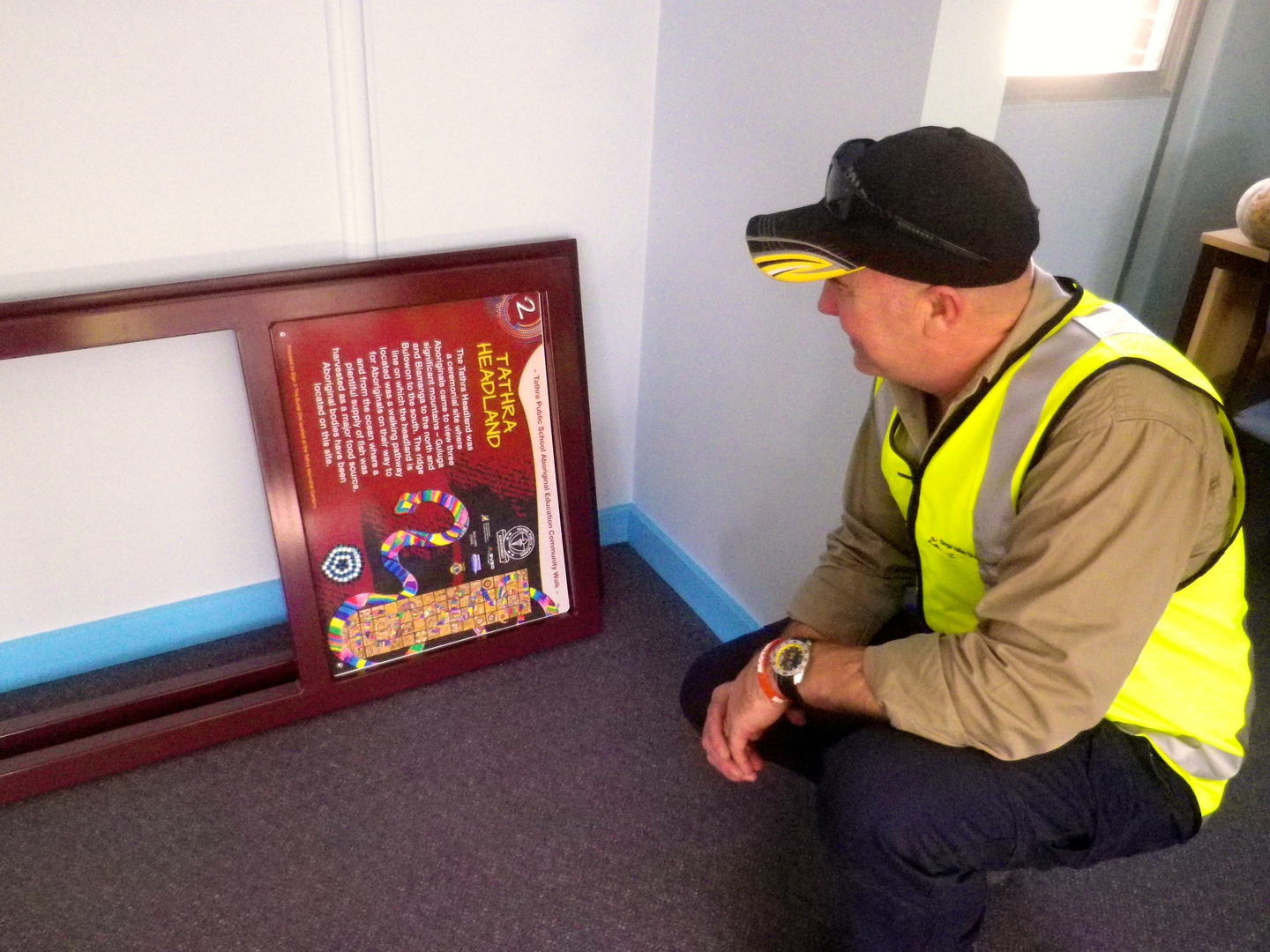 BVSC worker inspects a sign prior to placement at the Burial Site and the Headland.