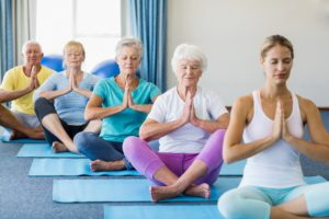 senior citizens doing meditation