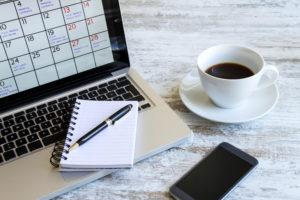 productivity_laptop_notepad_shutterstock_215559013