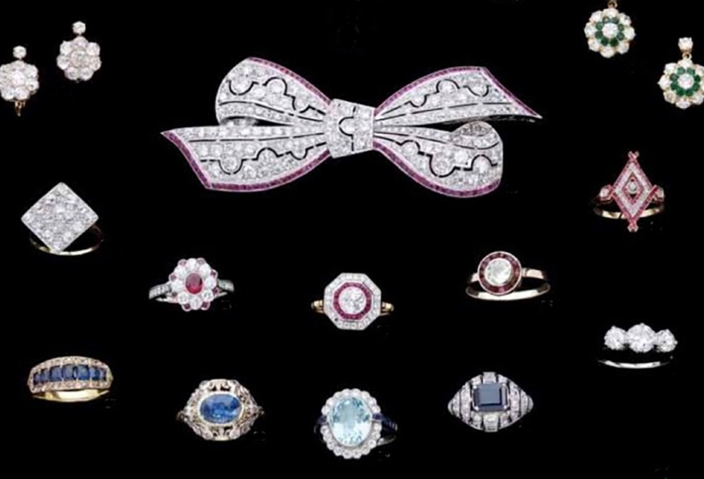 Superb Art Deco platinum diamond and ruby bow brooch among a selection of rings at AA&ADA member Anne Schofield Antiques