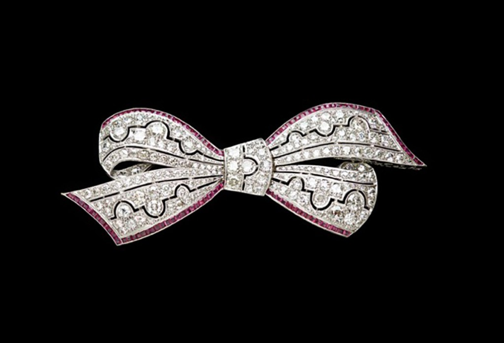 Anne Schofield Antiques  Superb Art Deco platinum diamond and ruby bow brooch.