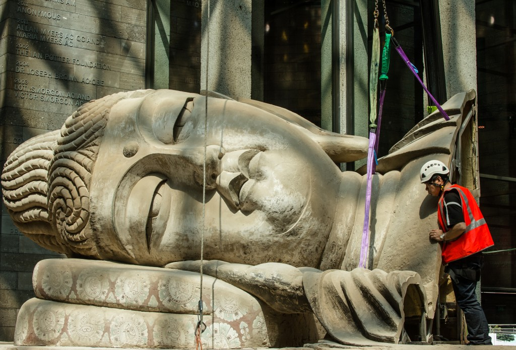 Eternity Buddah in Nirvana by Chinese artist Xu Zhen being installed at the NGV. Picture: Eugene Hyland