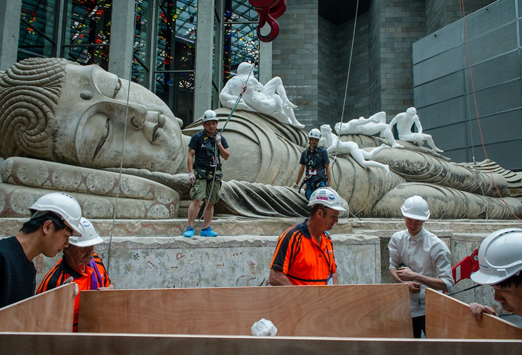 "The final elements of ""Eternity Buddah in Nirvana"" by Chinese artist Xu Zhen being installed at the NGV. Picture: Eugene Hyland"