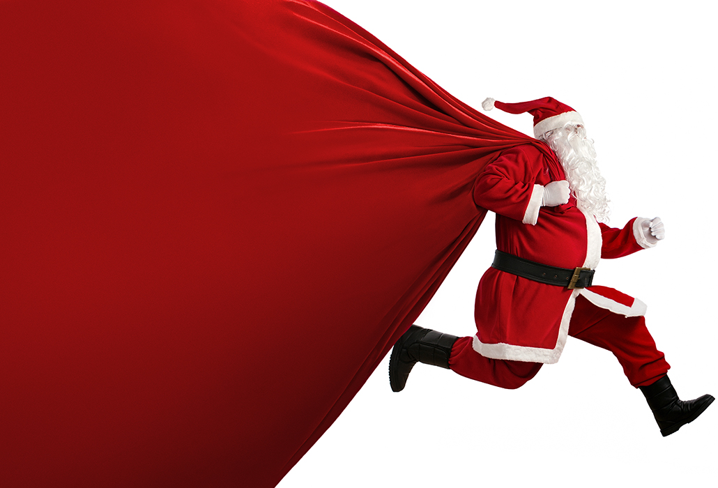 Santa Claus with a huge bag on the run