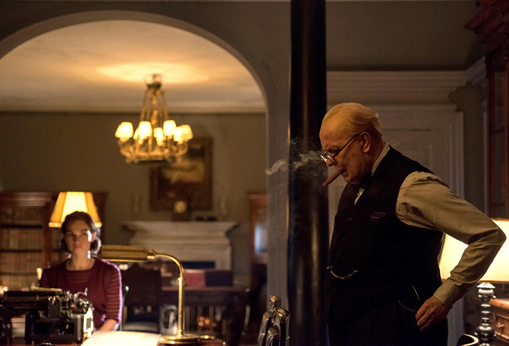 Lily James stars as Elizabeth Layton and Gary Oldman as Winston Churchill in director Joe Wright's DARKEST HOUR, a Focus Features release. Photographer Jack English