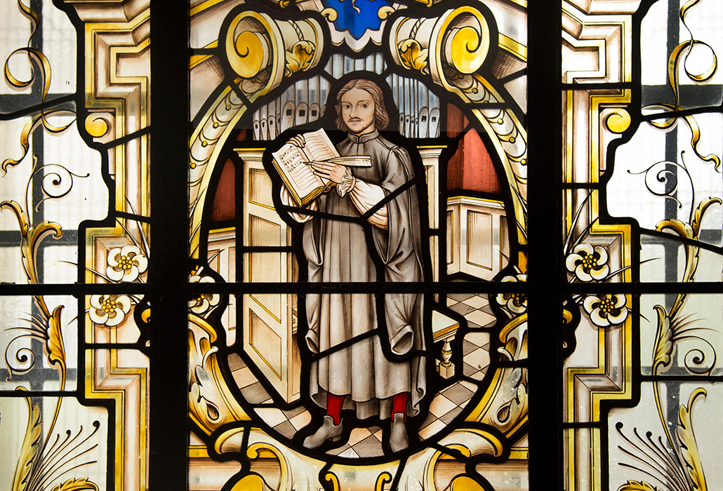 Thomas Tallis, composer of English choral music, depicted in stained glass window at St Alfege church, Greenwich, London.