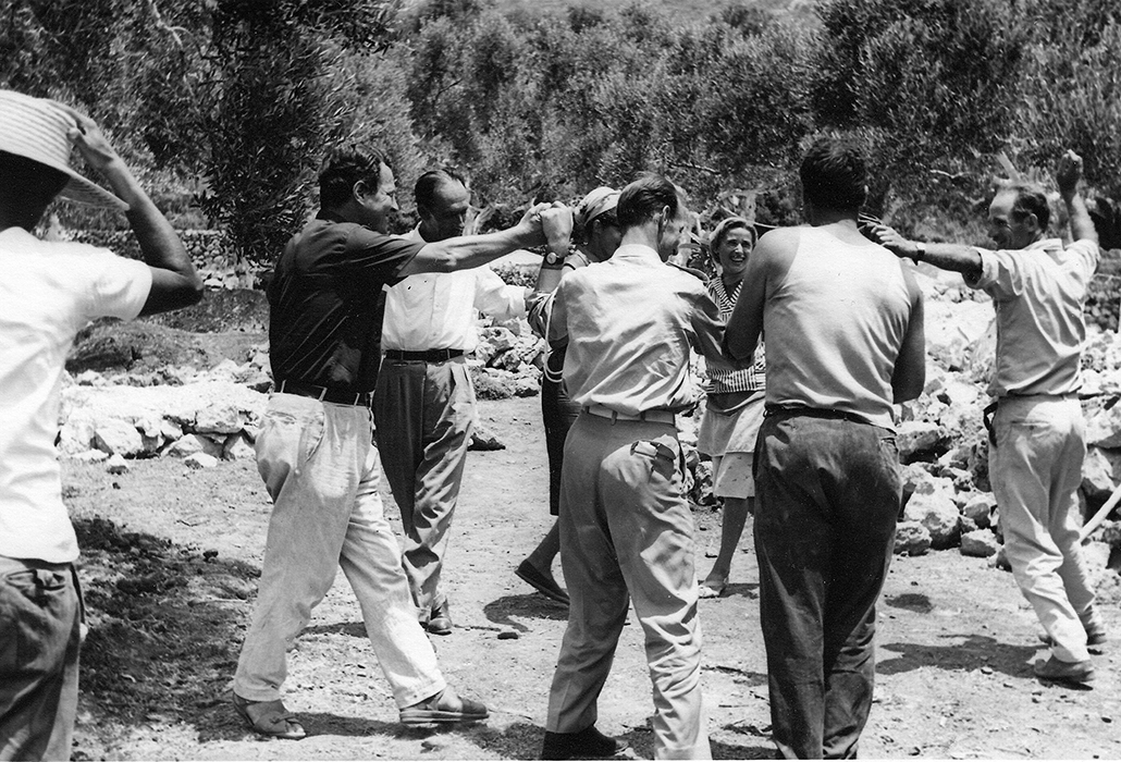 Patrick Leigh Fermor dancing with the builders during the construction of the house in Kardamyli, 1965. Photo: Joan Leigh Fermor. National Library of Scotland, Joan Leigh Fermor Photographic Collection. © Estate of Joan Leigh Fermor
