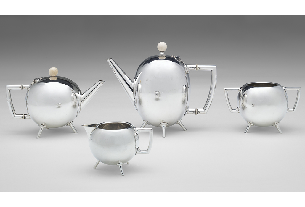Christopher Dresser (designer); Hukin & Heath, Birmingham (manufacturer) Tea service 1879 silver electroplate, ivory (a) 17.7 x 22.0 x 11.3 cm (hot water jug) (b) 13.2 x 19.6 x 11.1 cm (teapot) (c) 9.4 x 15.0 x 10.0 cm (sugar bowl) (d) 6.9 x 11.2 x 7.6 cm (milk jug) National Gallery of Victoria, Melbourne Purchased through the NGV Foundation with the assistance of Mr Hugh Morgan AC, Governor, 2002