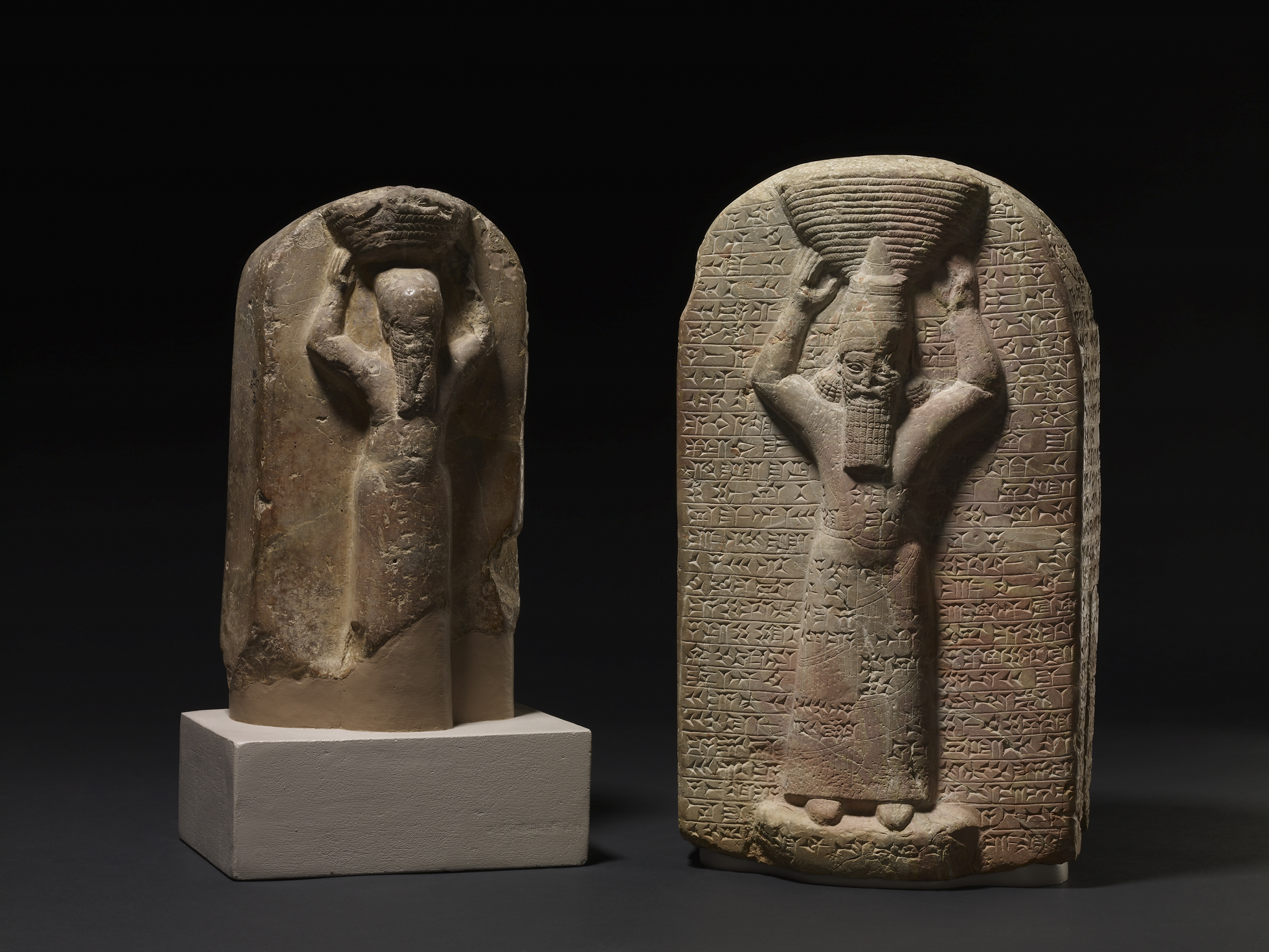 Shamash-shumu-ukin and Ashurbanipal Stone stele depicting Ashurbanipal (right), shown with a ritual basket on his head with cuneiform inscription, South Iraq, Marduk temple (Babylon), 668BC-665BC. His brother Shamash-shumu-ukin (left) carved with cuneiform inscription, South Iraq, Temple of Nabu (Borsippa), 668BC- 655BC © The Trustees of the British Museum