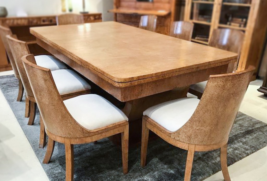 "Magnificent Karelian Birch Art Deco dining table with two extensions to three meters.  With eight matching solid curved back chairs which have been reupholstered in a macro suede fabric.  The table has a 'C"" curved support which rests on a shaped base. Date C1930, courtesy Virtanen Antiques"