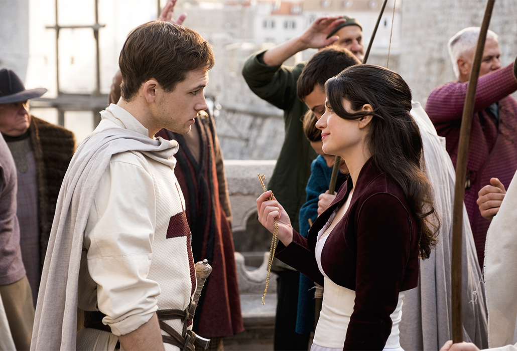 Robin (Taron Egerton) and Marian (Eve Hewson) in Robin Hood. Photo by: Larry Horricks.