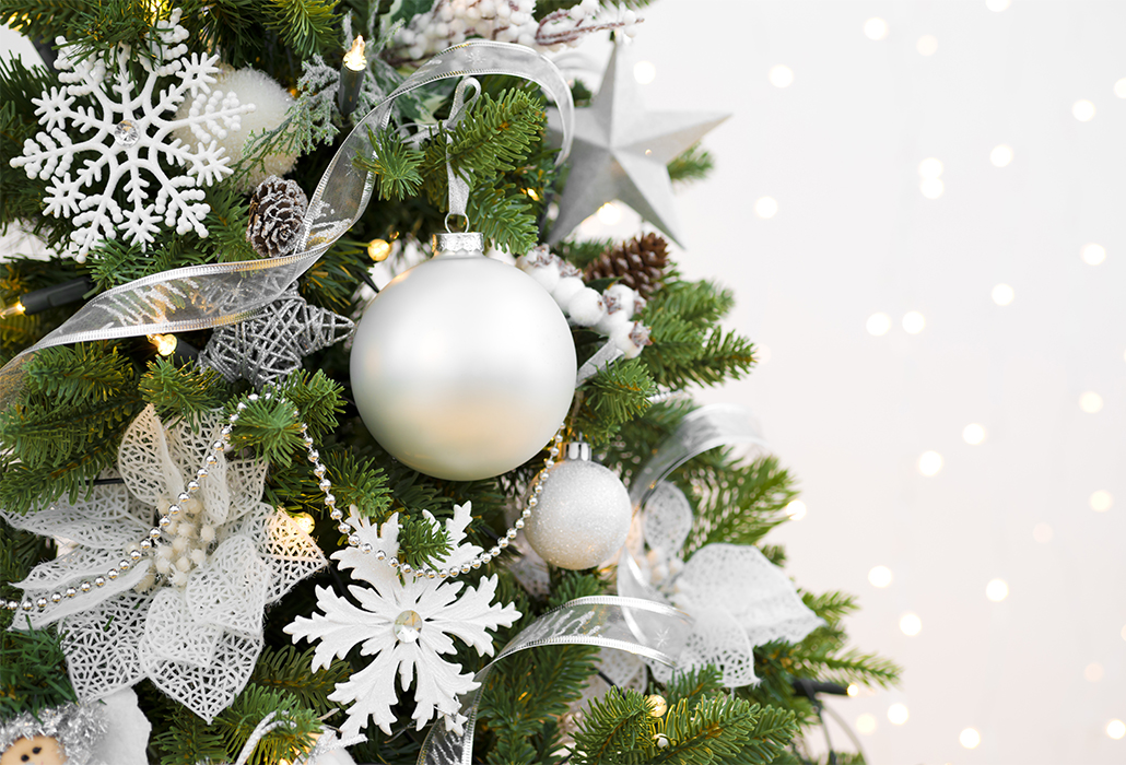 Decorated Christmas fir tree on abstract sparkling background with copyspace