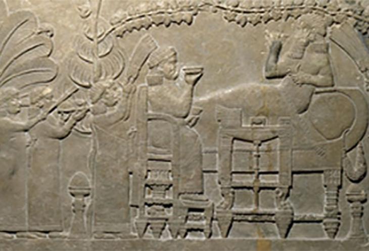King Ashurbanipal of Assyria feasting