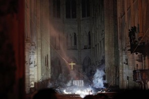 The Cross of Jesus, the Christ, illuminated among the ruins of Notre Dame Cathedral Paris, following the fire that nearly destroyed this shining icon at the heart of France and its people.