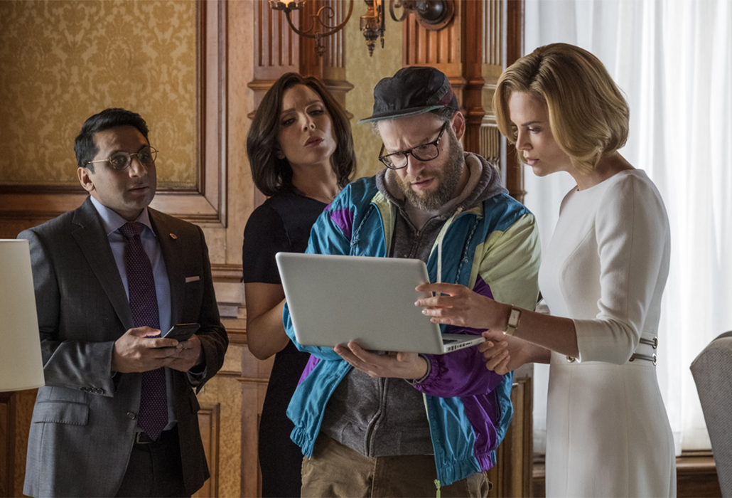 Tom (RAVI PATEL), Maggie (JUNE DIANE RAPHAEL), Fred Flarsky (SETH ROGEN), and Charlotte Fields (CHARLIZE THERON) in LONG SHOT. Photo Credit: Philippe Bossé.