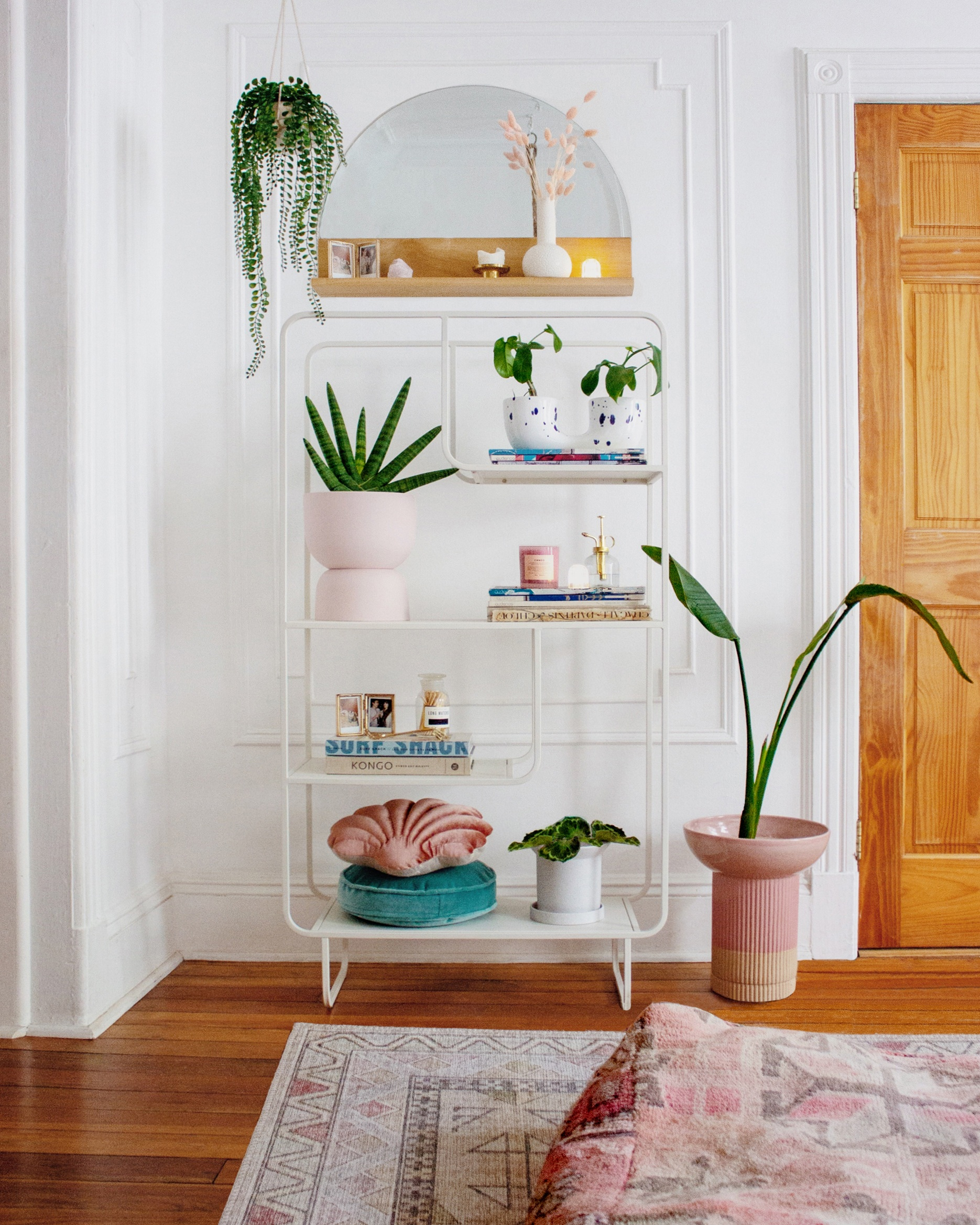 A beautifully plant-filled shelf styled by Mallory from @reserve_home featuring our Connected Plant Pot in Blue Crystal, Raw Earth Plant Pot in Rock Salt Pink, and Sandstone Plant Pot in White (Small).