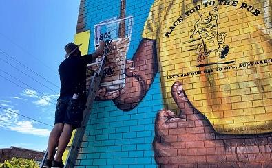 Hawke's update mural as 'Freedom Day' nears