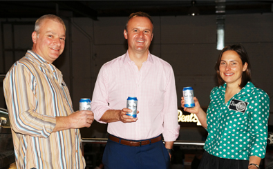 (l-r) Richard Watkins (BentSpoke co-owner and head brewer), Andrew Barr (ACT Chief Minister) and Tracy Margrain (co-owner and brewer) celebrate the launch of the BentSpoke Cannery