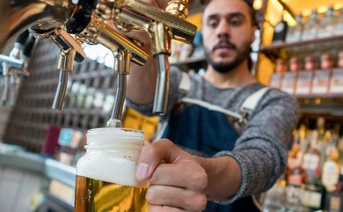 Man serving beer at a pub