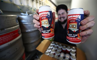 """AUCKLAND, NEW ZEALAND - SEPTEMBER 11: Andrew Childs of Behemoth Brewing Company arranges his Dump The Trump American Pale Ale on September 11, 2020 in Auckland, New Zealand. Behemoth Brewing Company first created their Dump the Trump American Pale Ale when Donald Trump was nominated in the U.S presidential race in 2016. Originally created as a joke when it was thought Trump would have no chance of being elected, the company stopped making the beer when he became president as """"it wasn't funny anymore."""" Behemoth Brewing Company started making the beer again two and a half years ago as things got """"more strange"""" in American politics. Started by Andrew Childs and his wife Hannah Miller Childs seven years ago in Mt Eden, Auckland, Behemoth Brewing Company contract-brews their beer at different breweries around New Zealand but are now setting up their own brewery behind the bar they opened in August 2020. The brewers have created a range of anti-Trump labels including ImPEACHment Sour Ale, Collusion and American Hopped Russian Imperial Stout. Andrew Childs says he hopes after 2020 they won't have to make Dump the Trump again. Despite receiving negative feedback on social media from Trump supporters when they launched the label,  the brewers say they like to refer to pop culture in a satirical way when naming and labelling of their beer. (Photo by Fiona Goodall/Getty Images)"""