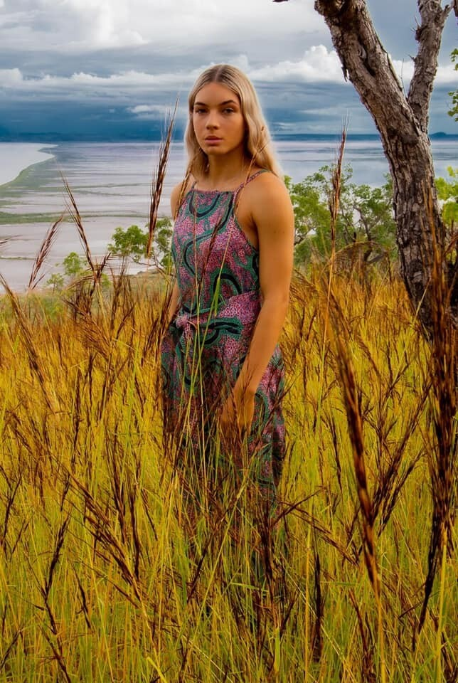 Model standing in tall grass