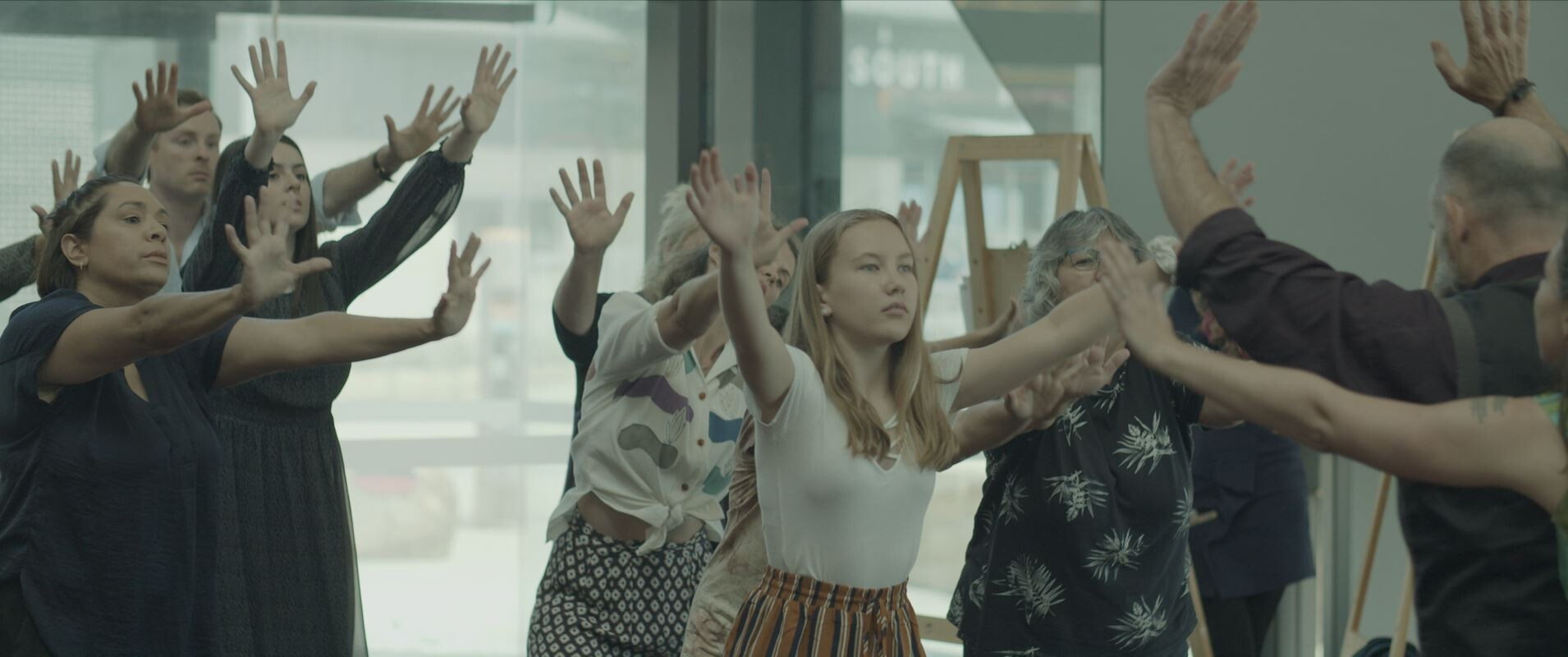 Participants with arms outstretched