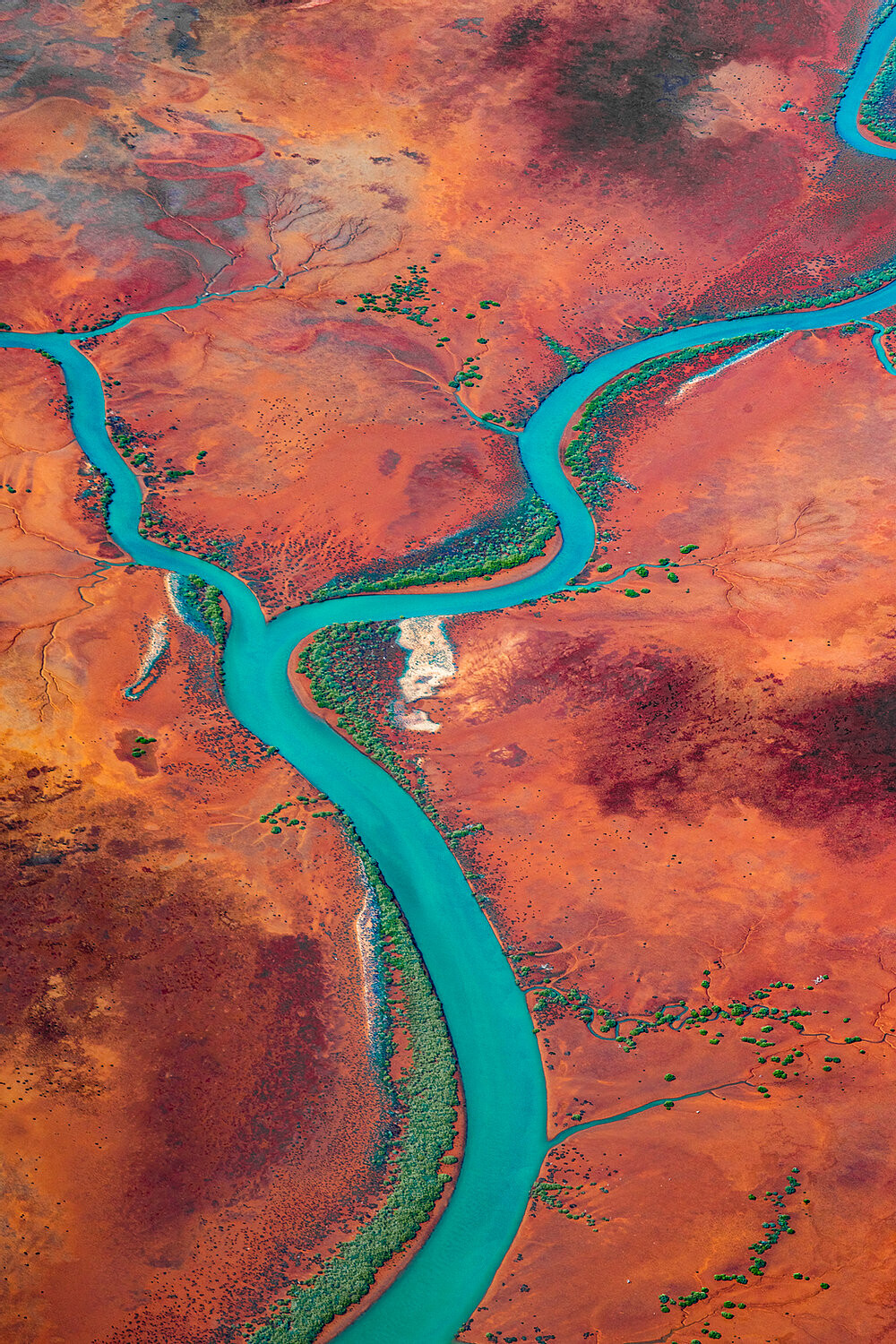 Aerial photo of river across red dirt