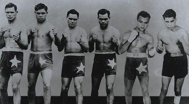 The six Sands brothers in fighting poses - Clem, Ritchie, George, Dave, Alf and Russell, 1943-1952 (Courtesy National Library of Australia, https://nla.gov.au/nla.obj-148524597)